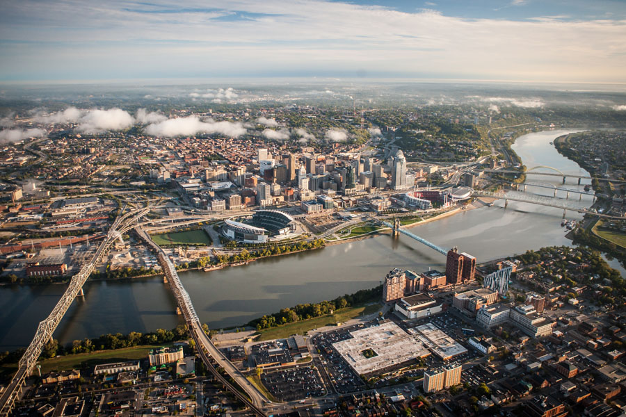 Cincinnati, OH Insurance - Overhead View of the City with Clouds Floating