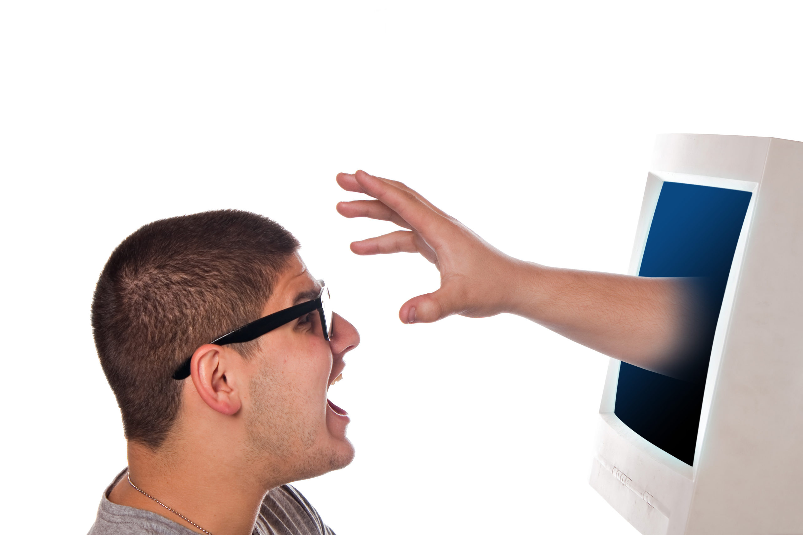 hand reaches out from computer monitor